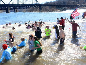 """They came in business suits and costumes, tutus and next to nothing at all. Around 555 people in all braved the February cold Saturday to jump into the Delaware River at Easton, during the seventh annual Lehigh Valley Polar Bear Plunge to benefit Special Olympics Pennsylvania. It might have seemed mild in the sunshine, as the air temperature cleared 40, but there was a northwest wind to reckon with on soaked skin. """"It was awesome, such an adrenaline rush,"""" said Holly Geosits, who plunged with co-workers at Good Shepherd Rehabilitation Network. """"Once you got in you just kept going so I didn't even feel it. It was on my bucket list so now I have one thing to check off."""""""