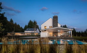 Architect Chris Kimpel of Rockefeller Kempel Architects says he wanted to nurture a sense of tranquility and familiarity with open, informal rooms that allow natural light to stream through tall windows, transparent walls, glass doors and well-positioned skylights.