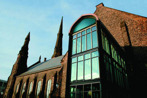 This restored church-turned-arts center is located in the heart of Buffalo's Theater District at the corner of Delaware Avenue and Tupper Street. In 1996, DiFranco and Fisher started a grass-roots effort to prevent the building from getting destroyed after an outcry from community activists, preservationists, and the general public.