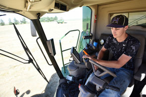 In June, Hermiston high school senior Trevor Horn drove a combine to harvest Kentucky blue grass at Golden Valley Farms just outside Stanfield.