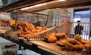 "When Rahman Mogilles is in the zone, he can turn out 240 pieces of fried chicken – each one the same shade of golden brown – in 30 minutes at McHardy's Chicken and Fixin'. Mogilles is at the restaurant on North Broad seven days a week with his focus trained on the bird. Unlike some who make the same dish day in and day out, however, he still digs into his chicken with relish. ""I eat it every day,"" he said."