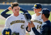 Michigan baseball, softball continue long win streaks with weekend sweeps