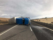 Semi-truck blown over by high winds on I-84