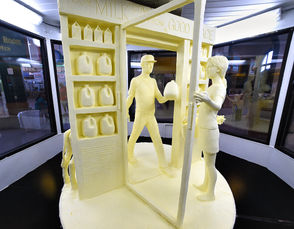 A dairy farm family is the theme for this year's fair butter sculpture.