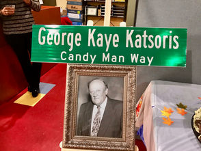 """During a heartfelt ceremony Saturday afternoon in Bloomfield, a street was renamed in honor of George Kaye Katsoris at the corner of Travis and South avenues. Dubbed the """"Candy Man,'' but affectionately known as George Kaye, Katsoris who died at 94 in November of 2015, will always be remembered as Staten Island's premier chocolatier and the borough's most famous candy maker. As president of Supreme Chocolatier in Bloomfield, Katsoris worked at the more-than-century-old business until he took sick, said his wife of 63 years, Evangeline (Van) Katsoris. Said Evangeline: """"I thought my husband was an exceptional man and led a good life. He was a great businessman and was always trying new things. He dealt with manufacturers at Russell Stover and Godiva and many others."""""""