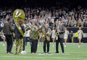 """Chances are, even if you weren't in the Mercedes-Benz Superdome for the Saints-Eagles playoff game on Sunday (Jan. 13), you probably heard about the Preservation Hall Jazz Band's singular, toe-tapping rendition of the National Anthem. It's not every day, after all, that """"The Star-Spangled Banner"""" sets social media abuzz -- and has WWL Radio broadcasters Zach Strief and Deuce McAllister gushing that it should be performed that way all the time. Now, you can watch it for yourself. The New Orleans Saints organization has posted a video of the performance in its entirety to its website. You can watch it at www.neworleanssaints.com.  Of course, presenting a starkly original arrangement of such a sacred song can be risky business. Just ask Roseanne Barr, who famously turned it into a joke before a 1990 San Diego Padres baseball game, or singer Fergie, who had to apologize for her performance of the Anthem before the 2018's NBA All-Star game. Neither have yet to live those performances down. """"You can't imagine the amount of pressure you put on yourself when you know you're performing in front of 80,000 people,"""" Pres Hall sousaphonist Ben Jaffe told WWL-TV with regard to the performance. Fortunately, the Pres Hall rendition drew mostly praise as a suitably reverently but unmistakably New Orleans-y one, as evidenced by the below Twitter reactions."""