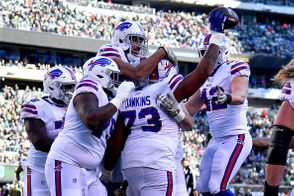 "East Rutherford, N.J. -- Offensive lineman Dion Dawkins caught a seven-yard touchdown in the Buffalo Bills' 41-10 blowout against the New York Jets. Dawkins didn't want to give too much away about the play because he's hoping the Bills pull out the trick play again in the future.  ""It was, 'Get Dion in the end zone, on one.' That was it. And that's what happened,"" Dawkins said. ""It's been (installed in our playbook), but we just had to get in the right position to execute the play."" Things were going so well for the Bills on offense Sunday that offensive coordinator Brian Daboll scrolled way down on his call sheet to dial up the Dawkins pass play. Buffalo quarterback Matt Barkley, who was thrown in to start after signing with the Bills less than two weeks ago, torched the Jets. He threw two touchdowns and almost had a third, but Zay Jones had the ball stripped at the goal line and tight end Jason Croom fell on the loose ball in the end zone. On the touchdown pass to Dawkins, Barkley got the defense to bite on a play-action fake, and he sailed the ball over the linebacker to a wide open Dawkins, who looked like a monster tight end making the grab. Dawkins, who was playing his home state of New Jersey, said it was a special moment for him and his family. ""In high school I scored on defense, and this was big to score a touchdown in Jersey,"" Dawkins said. ""After the game I went over to my mother and she was crying. It's a big deal."""