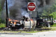 Driver pulled from burning pickup after crash, police say (PHOTOS)