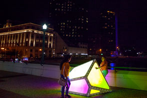 """Nadia Juarez, left, Karla Padilla look at Ryan Swanson's ArtPrize entry """"Oscillation"""" on the Gillett Bridge in Grand Rapids on Wednesday, Sept. 19, 2018. From the artist: Oscillation is an interactive installation that focuses on creating community activity and social interaction through play."""
