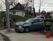 1 injured in crash into utility pole outside Dunkin' Donuts