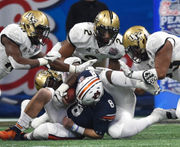 UCF caps perfect season with 34-27 win over Auburn in Peach Bowl