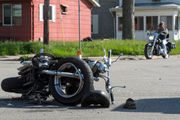 Vehicle crashes into motorcycle sending cyclist to hospital