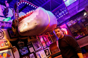 """BTW: This is the only known """"Jaws"""" model in one piece, which John said was his main motivation for purchasing it. To get it into the restaurant, the brothers had to remove the front window and use a crane. """"It was a lot of work, but it actually inspired us to bring our collection to the restaurant,"""" John Ryan said. """"We're in the process of making our own little 'Jaws' area."""""""