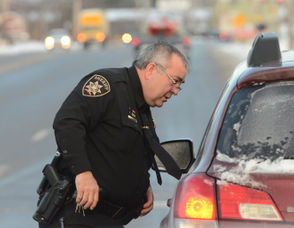 Onondaga County Sheriff Deputy Michael Quigley pulls over a driver on Old Liverpool Road in the town of Salina.