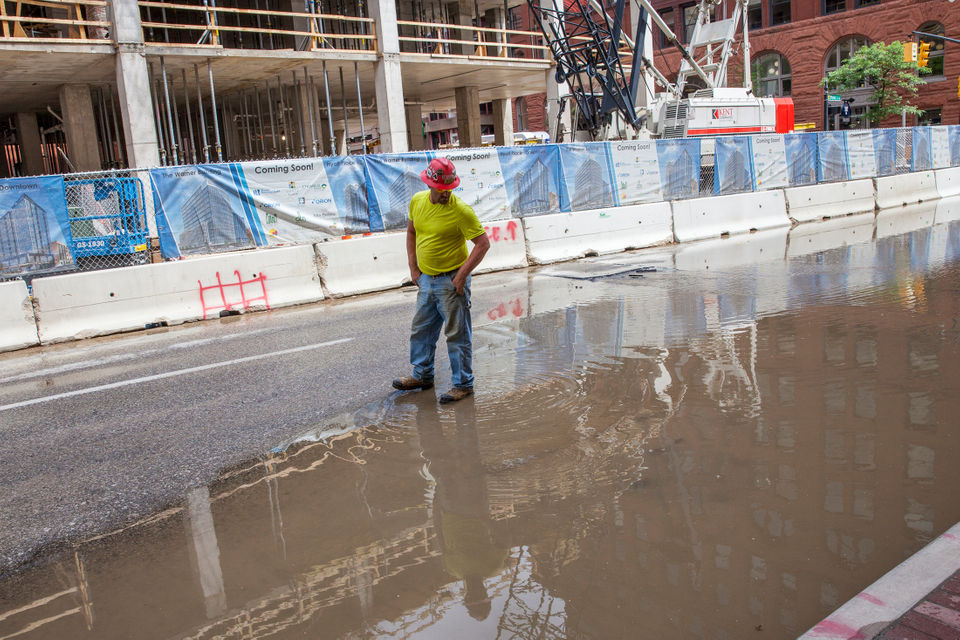 Water main break near the construction of The Warner Building and Hyatt Place on Ionia Avenue NW in Grand Rapids