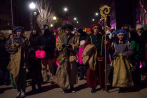 Helpers of Sinterklaas pass out candy canes to children as he leads a procession in downtown Holland, MI on Friday, Dec. 7, 2018.