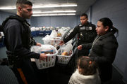 Trenton police collect record number of donations for Thanksgiving food baskets