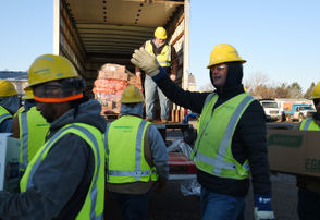 Photos as Consumers Energy employees deliver turkey dinners to customers affected by work done by the utility.