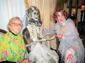 Great Gatsby ghost and event chair Maryflynn Thomas, right, introduces the skeleton bride to Ann Duffy.