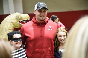 The University of Alabama Student-Athlete Advisory Committee once again hosted the Halloween Extravaganza at the Hank Crisp Indoor Facility where football, baseball, tennis players and all sorts of student-athletes played games, took photos and handed out candy with children and families on Monday. See photos from the event below. Pictured here is Alabama offensive lineman Ross Pierschbacher with fans.