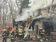 Firefighter injured in stubborn house blaze