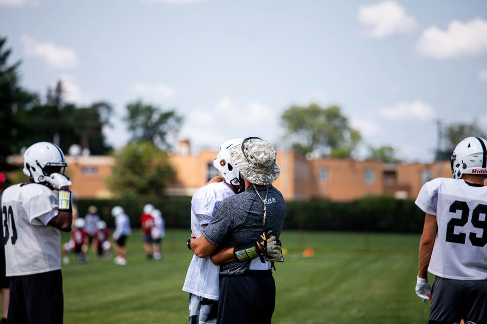 Grand Blanc football supports one another through loss of coach