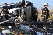 Rollover traps driver, leads to haz-mat cleanup (PHOTOS)