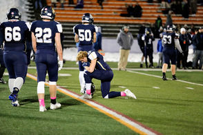 Skaneateles WR Nick Wamp takes a knee after their hard fought loss to Batavia. Skaneateles High School vs. Batavia High School in a NYPHSAA Class B state semi-final at Union-Endicott High School, Endicott, NY, Saturday, November 17, 2018.