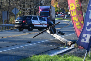 A car took out a utility pole, bringing down wires, and rolled Nov. 10, 2018, on Route 31 in Washington Township, N.J.