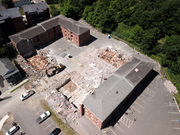 City starts demo of former apartment complex to extend road, parking