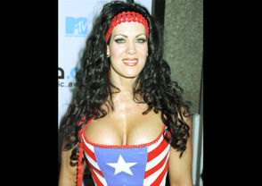 Wrestling personality Chyna poses for photographers September 7, 2000, at the 2000 MTV Video Music Awards at Radio City Music Hall in New York City.