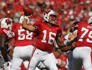 Though Wilson wasn't the first graduate transfer quarterback, he became the poster child for the practice when he left the Wolfpack for the Badgers in 2011. Wilson had enjoyed three outstanding years at N.C. State, passing for 8,545 yards and 75 touchdowns as the Wolfpack won 24 games and played in three straight bowl games. However, a dispute with head coach Tom O'Brien over Wilson's desire to play professional baseball with the Colorado Rockies during the summer of 2011 led Wilson to seek another school for his final season. He transferred to Wisconsin, where he passed for 3,175 yards and 33 touchdowns and led the Badgers to the Big Ten championship. Considered too short for the NFL at 5-foot-11, Wilson slipped to the third round of the 2012 draft. In seven seasons with the Seattle Seahawks, he's been NFL Rookie of the Year, earned six Pro Bowl berths and played in two Super Bowls, winning one.