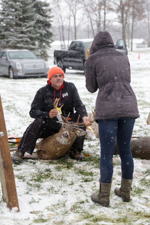 Gordon Gotz poses with his buck during the 11th annual Buck Pole, Thursday, Nov. 15, 2018 at Jerome Country Market in Jerome. (Nikos Frazier   MLive.com)