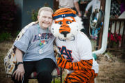 Auburn celebrates sick staffer with surprise birthday parade