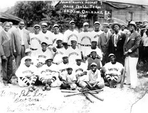"It's perhaps one of the most intriguing photos of Louis Armstrong.  Taken in 1931, the image shows Satchmo smiling as he stands with 17 young men looking quite dapper in bright, white new baseball uniforms, the word ""Armstrong"" emblazoned across their plush cotton jerseys. Armstrong is pictured leaning on a baseball bat, while two bat boys sit on the ground in front, a pile of bats and a catcher's mask at their feet. The picture is the only known photograph of the Armstrong Secret 9 semipro baseball team, a squad bankrolled by the cornet legend. The vintage photo has been published and republished in numerous New Orleans and national media outlets, accompanying stories and books about jazz lore, New Orleans history and the Negro Leagues, the segregation-era black baseball teams and circuits that existed before Jackie Robinson and others integrated America's pastime in the 1940s and '50s. And for a month this past summer, visitors to the International House Hotel in New Orleans were greeted by a mural-sized reproduction of the image. Sean Cummings, CEO of Ekistics, Inc., a development firm that renovated and converted the building into a hotel, had the iconic photo blown up. With help from Inkwell Press in the Bywater and using meticulous research, the hotel also reproduced Secret 9 jerseys, including the fabrics used in 1931 to create the originals. It was part of a renewed effort, involving Cummings and others, to bring more public attention to the image in hopes of solving a long-standing mystery: Who, exactly, are the gentlemen pictured in the famous photo?"
