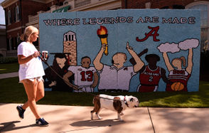 "The University of Alabama homecoming week is never complete without the annual sorority lawn decorations, and they didn't disappoint this year. Nick Saban, Tua Tagovailoa and Big Al were prominently featured, along with the theme ""Excellence Lights the Crimson Flame."" See the 2018 designs below."