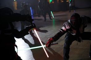 Of course, the LED-lit, rigid polycarbonate lightsaber replicas can't slice a Sith lord in half. But they look and, with the more expensive sabers equipped with a chip in their hilt that emits a throaty electric rumble, even sound remarkably like the silver screen blades that Yoda and other characters wield in the blockbuster movies .