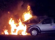 Pickup truck burns in car lot, second vehicle damaged