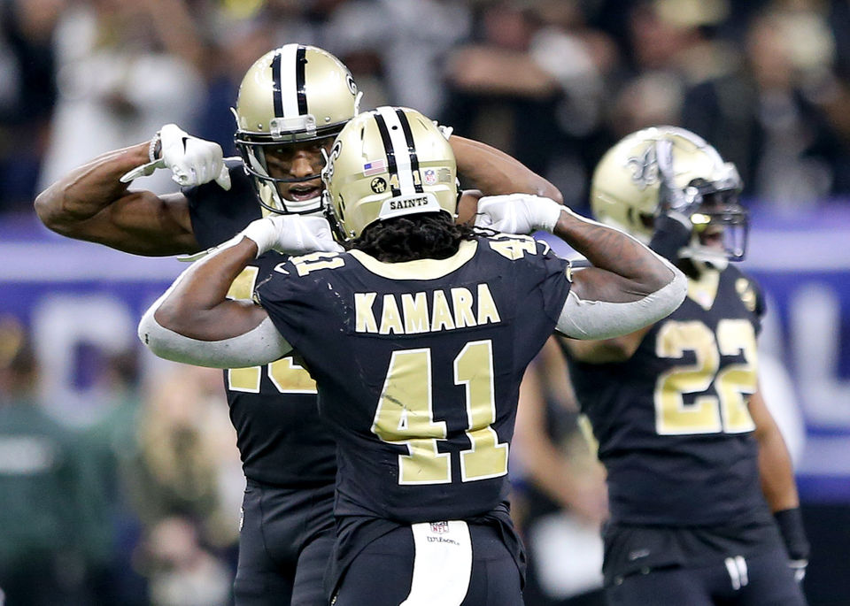 d7612f744 Saints wide receiver Michael Thomas and running back Alvin Kamara celebrate  as running back Mark Ingram waves good-bye during the Divisional Playoff  Game ...