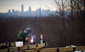 PARMA, Ohio—Even in a freeze, the Cleveland Metroparks keep laying out trails. The other day, two workers were driving poles into a snowy peak to top West Creek Reservation's new Lookout Ridge Trail with an observation deck for a wide view of downtown Cleveland. The 102-year-old Cleveland Metroparks system has added about 26 miles of trails with natural surfaces since 2012 and replaced another six miles. Since 2016, crews have also given those trails more than 1,500 feet of boardwalks, footbridges and decks.