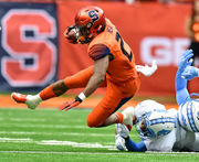How many people attended Syracuse football's Homecoming game vs. North Carolina?