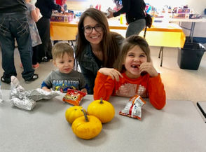 Families enjoyed games like pumpkin bowling, ring toss, doughnut walk, three-legged race and haystack scramble.