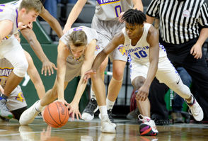 Frankfort's Luke Hammon (5) and Southfield Christian's Jon Sanders (10) battle for the ball during the MHSAA Division 4 boys basketball championship game at the Breslin Center at Michigan State University on Saturday, March 16, 2019.