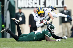 FINAL: Michigan 21, Michigan State 7 EAST LANSING, Mich. -- It wasn't pretty, but it never is. The long, daunting road losing streak against ranked opponents on the road is over. No. 6 Michigan overcame a slow start offensively Saturday to beat in-state rival Michigan State, 21-7, before 76,131 at Spartan Stadium in East Lansing. The win zapped a skid that had hit 17 straight losses, a stretch that spanned more than a decade and included a season-opening loss at Notre Dame. The Wolverines (7-1, 5-0 Big Ten) entered the game back in the top 10 nationally and knocking on the door to the College Football Playoff. A loss would have minimized those hopes, along with a quest for a Big Ten title. It also would have re-opened the criticism aimed at Michigan head coach Jim Harbaugh, who entered Saturday's game with a 1-5 record against rivals MSU and Ohio State. The win improves Michigan to 2-2 against the Spartans  under Harbaugh. It also leaves all of the Wolverines' goals ahead of them with a bye week on deck.