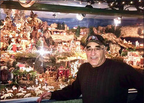 "STATEN ISLAND, N.Y. -- We know that John Miniero, a very charitable Brooklynite, displays an extraordinary Neapolitan Presepio outside his home each Christmas season.  The must-see display is located at 14th Avenue and 80th Street. But what some folks don't know is that the artist agreed to do an indoor display of his masterpiece at Casa Belvedere, the Italian Cultural Center on Grymes Hill, where he unveiled the newly created ""Bottle Presepi."""