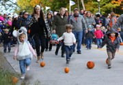 Why Michigan community has rolled pumpkins for 23 years