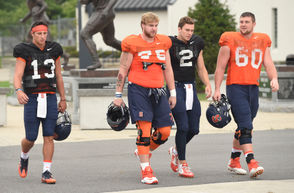Syracuse football's two top quarterbacks have continued to split first-team reps through Sunday's practice.  Both senior Eric Dungey and redshirt freshman Tommy DeVito have proven capable of moving the ball consistently. Both wore black, non-contact jerseys during SU's second scrimmage on Saturday, leading a few drives apiece before giving way to the second teamers.