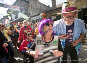 Ileana Diaz plays the washboard while dancing with Kurt Gauder as Parrot Heads from across the country gathered on Bourbon Street on Saturday, Jan. 19, 2019. (Photo by Brett Duke, NOLA.com | The Times-Picayune)