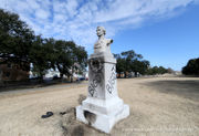 Confederate monument vandalized with paint, burning tire