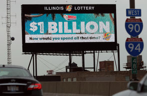 A digital billboard along I-90/94 highway in Chicago, displays the estimated Mega Millions jackpot, Friday, Oct. 19, 2018. AP Photo/Nam Y. Huh
